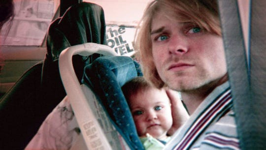 "Kurt Cobain with daughter Frances Bean Cobain in a photo from the documentary motion picture ""Kurt Cobain: Montage of Heck."""