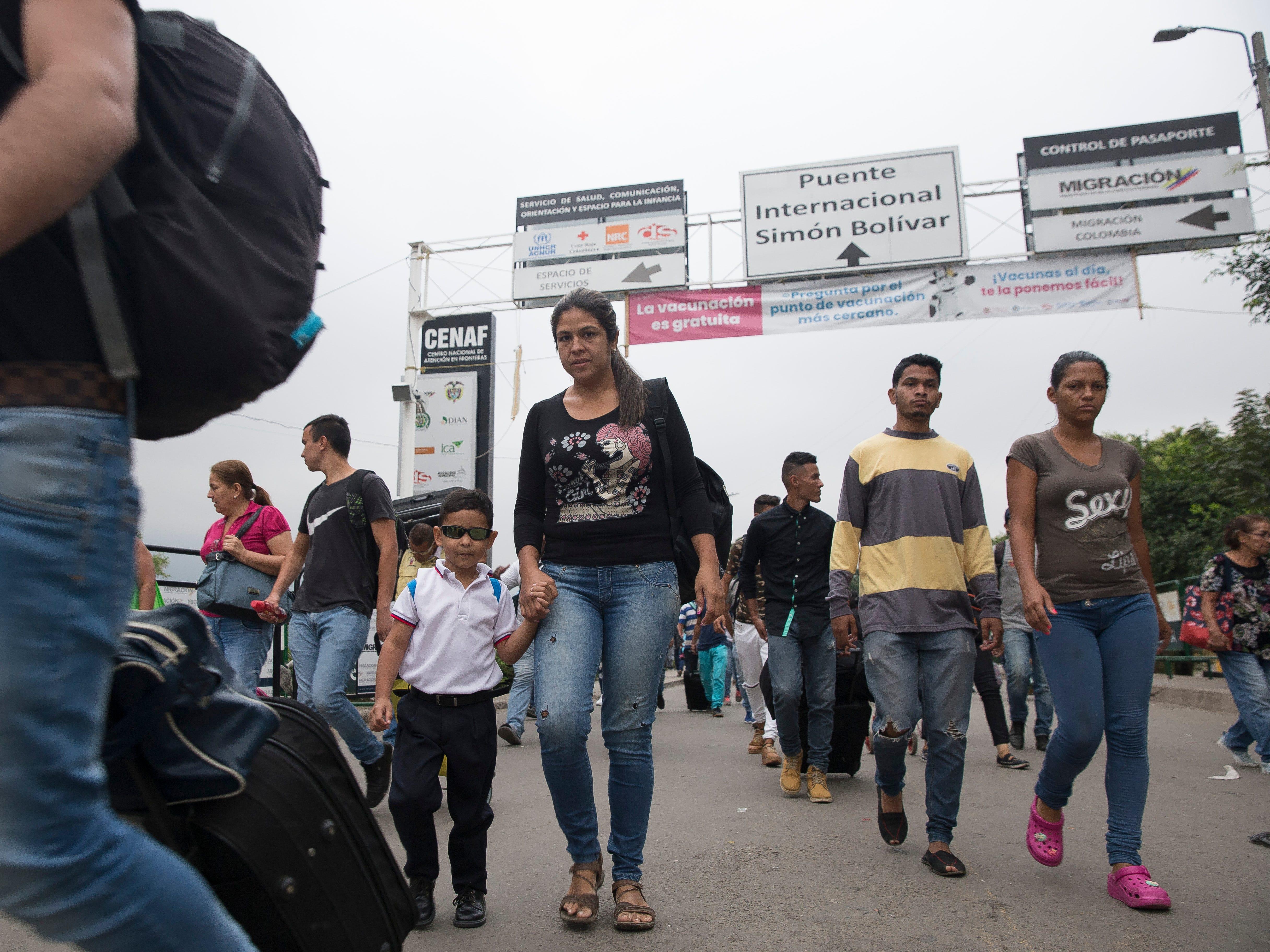 A flood of migrants cross the Colombia-Venezuela border on Feb. 6, 2019.
