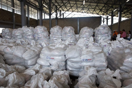 White sacks full of food and medicine from the United States sits waiting to cross the Colombia-Venezuela border to be distributed to starving people by Venezuelan opposition on Feb. 8, 2019.