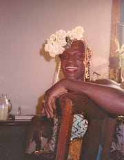 Her shimmering robes, red plastic high heels and floral headdresses made trans activist Marsha P. Johnson a muse of pop artist Andy Warhol.