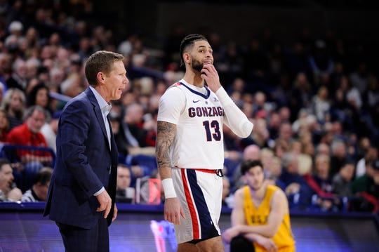 Gonzaga Bulldogs head coach Mark Few talks with guard Josh Perkins (13) during the second half against the San Francisco Dons at McCarthey Athletic Center. The Bulldogs won 92-62.