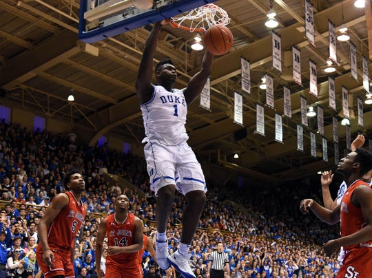 81d7b0e52403 Duke forward Zion Williamson dunks during the second half against St.  John s.