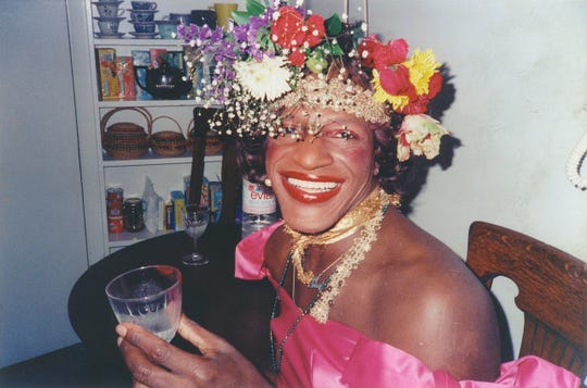 """Marsha P. Johnson said she never threw the first brick that started the riots at a gay bar in  fresh York called the Stonewall Inn, which police raided in June 1969. But she was  fragment of the """"vanguard"""" that resisted police during the demonstrations."""