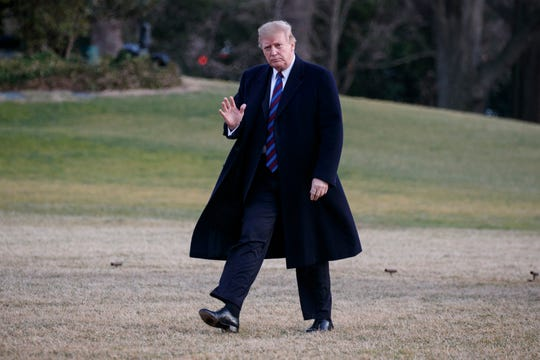 President Donald Trump gives waves as he arrives on Marine One on the South Lawn of the White House in Washington, D.C., Feb. 8, 2019, as he returns from his annual physical exam at Walter Reed National Military Medical Center.