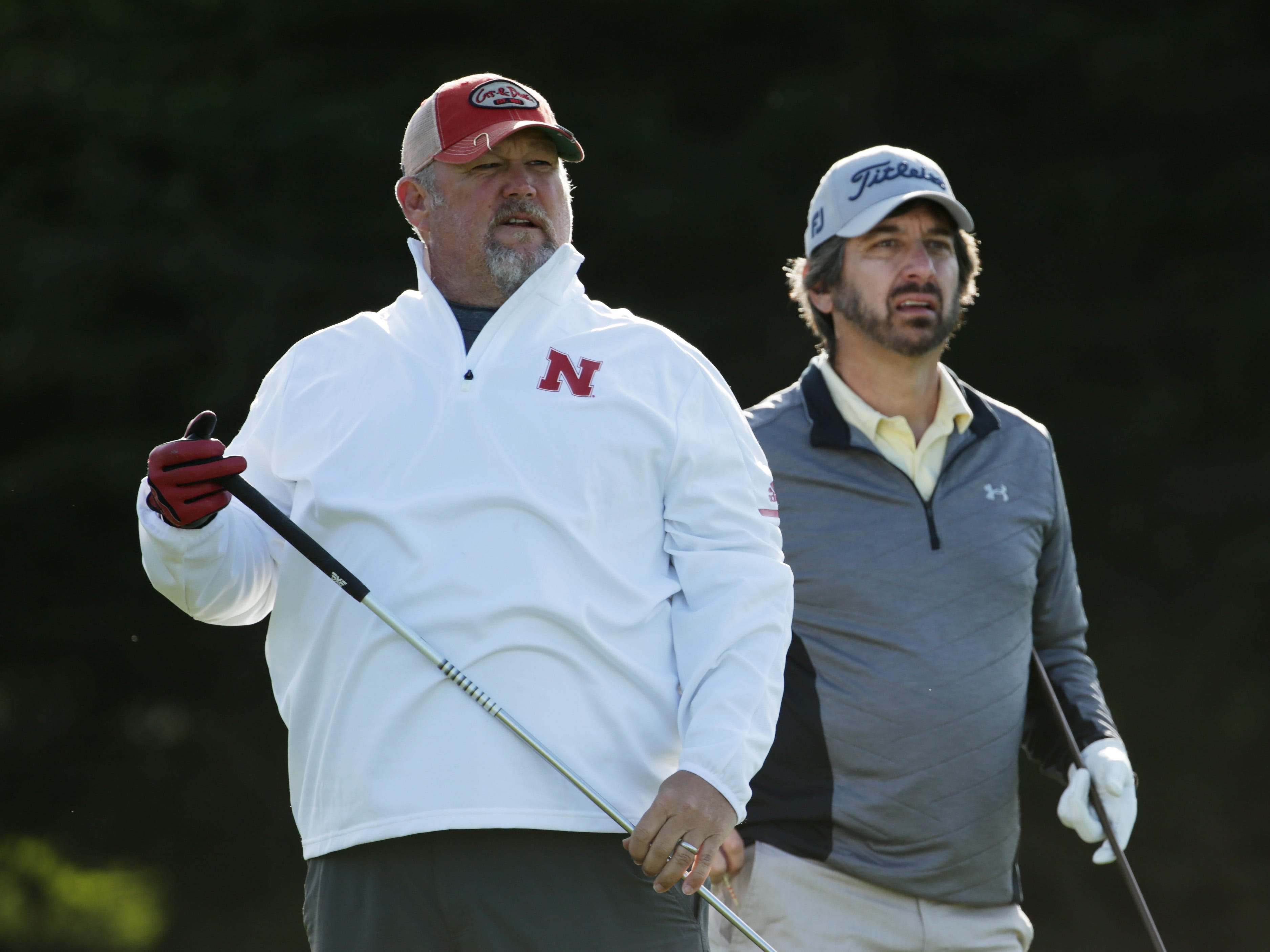 Larry the Cable Guy and Ray Romano look on from the fifth tee during the first round of the AT&T Pebble Beach Pro-Am.