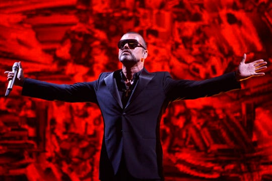 George Michael performs in Paris, in September 2012.