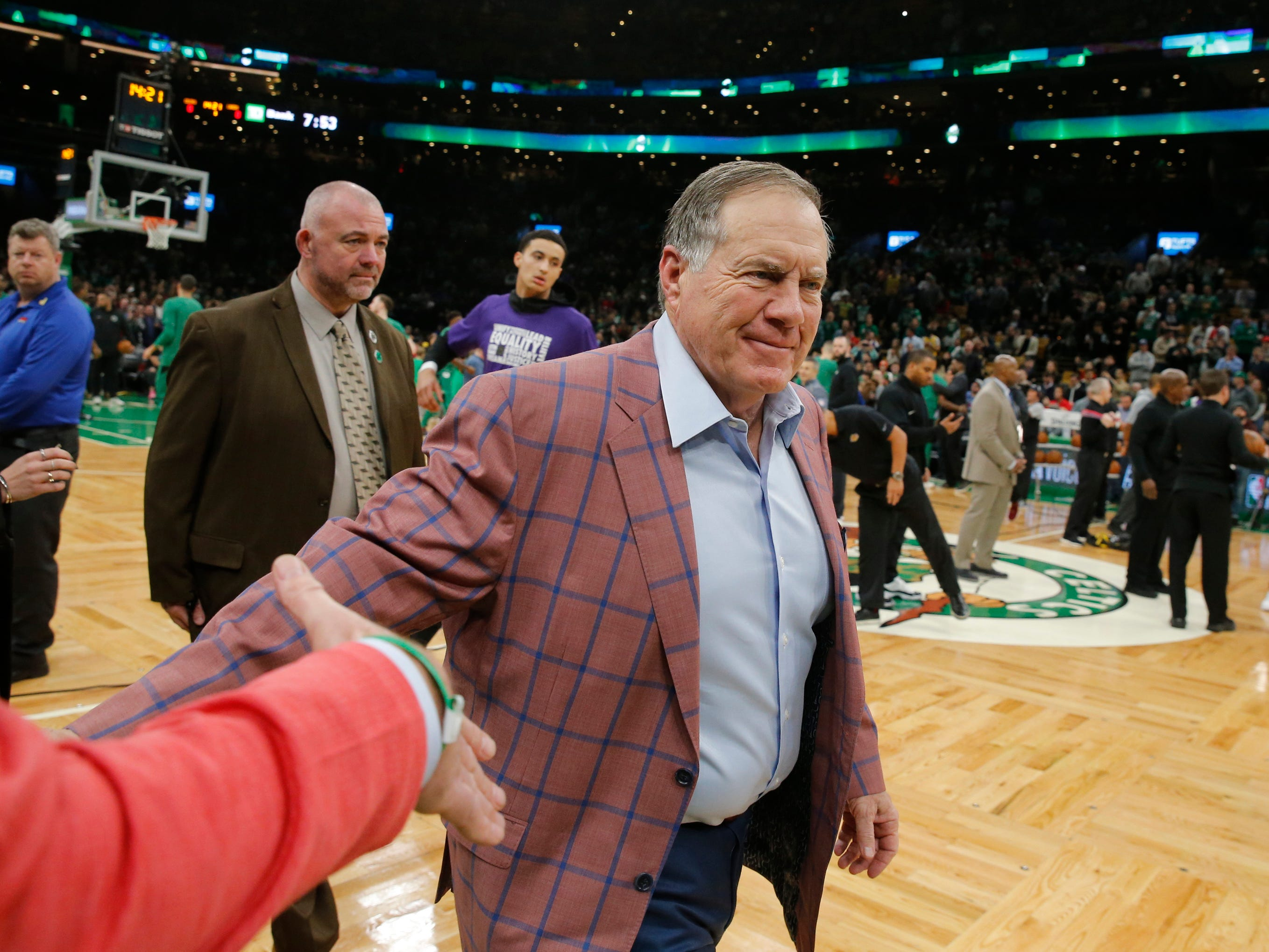 Feb. 7: New England Patriots head coach Bill Belichick walks to his seat before the start of the game between the Boston Celtics and Los Angeles Lakers  at TD Garden.