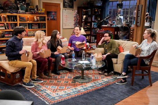 Howard Wolowitz (Simon Helberg), left, Bernadette (Melissa Rauch), Amy Farrah Fowler (Mayim Bialik), Sheldon Cooper (Jim Parsons), Leonard Hofstadter (Johnny Galecki) and Penny (Kaley Cuoco) gather for a meal on the familiar living room set of CBS's 'The Big Bang Theory.'