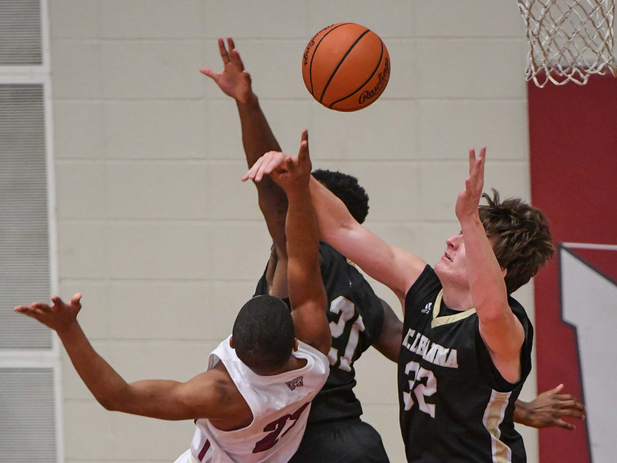 TL Hanna junior John Haddock Rogers(32) fouls Westside senior Paul Johnson(23) during the first quarter at Westside High School in Anderson on Friday.