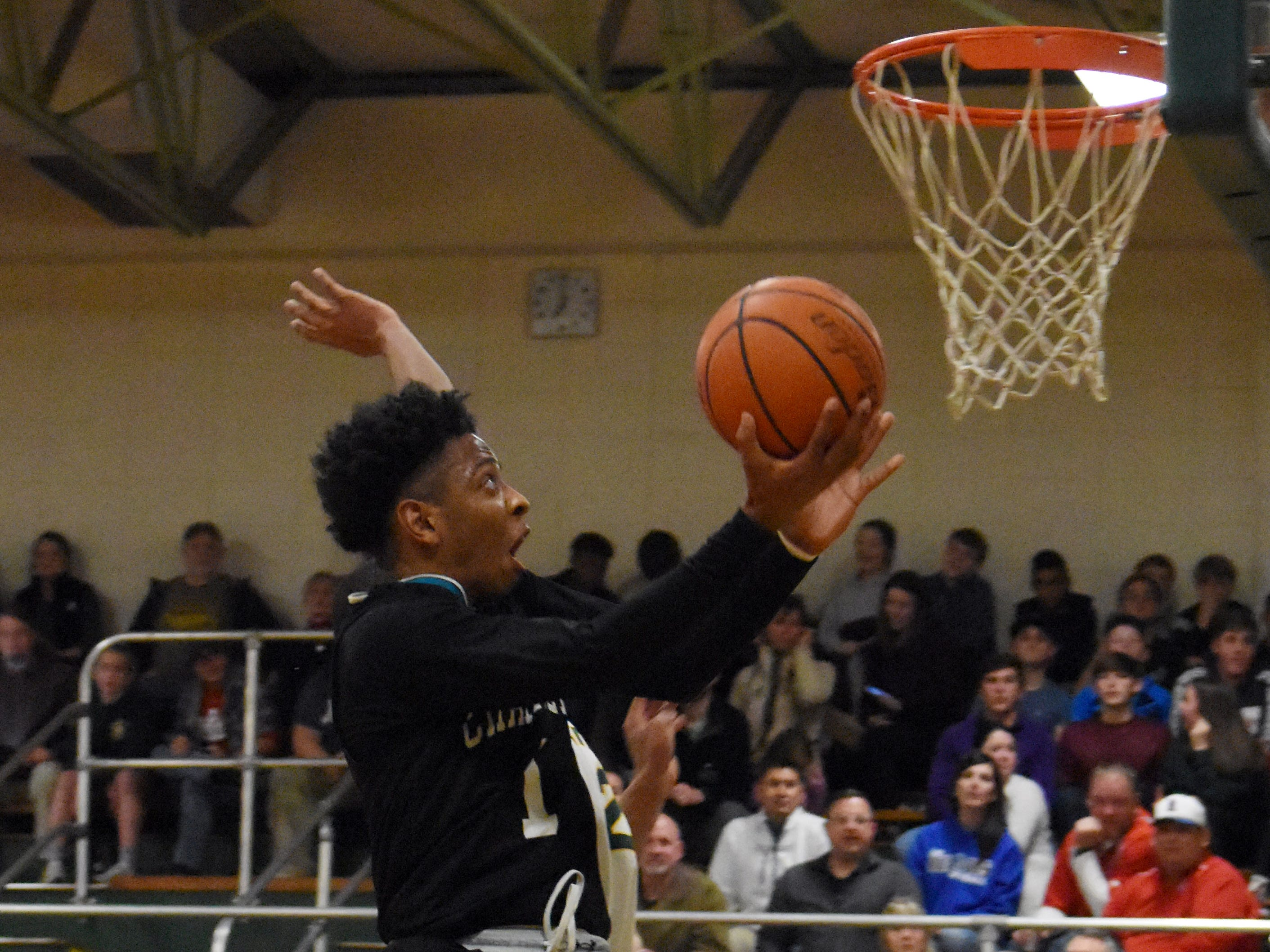 Avoyelles Charter senior Aaron McGhee (1) goes up for a layup against Holy Savior Menard Friday, Feb. 8, 2019. McGhee was named as the District 4-2A MVP for the second straight year.