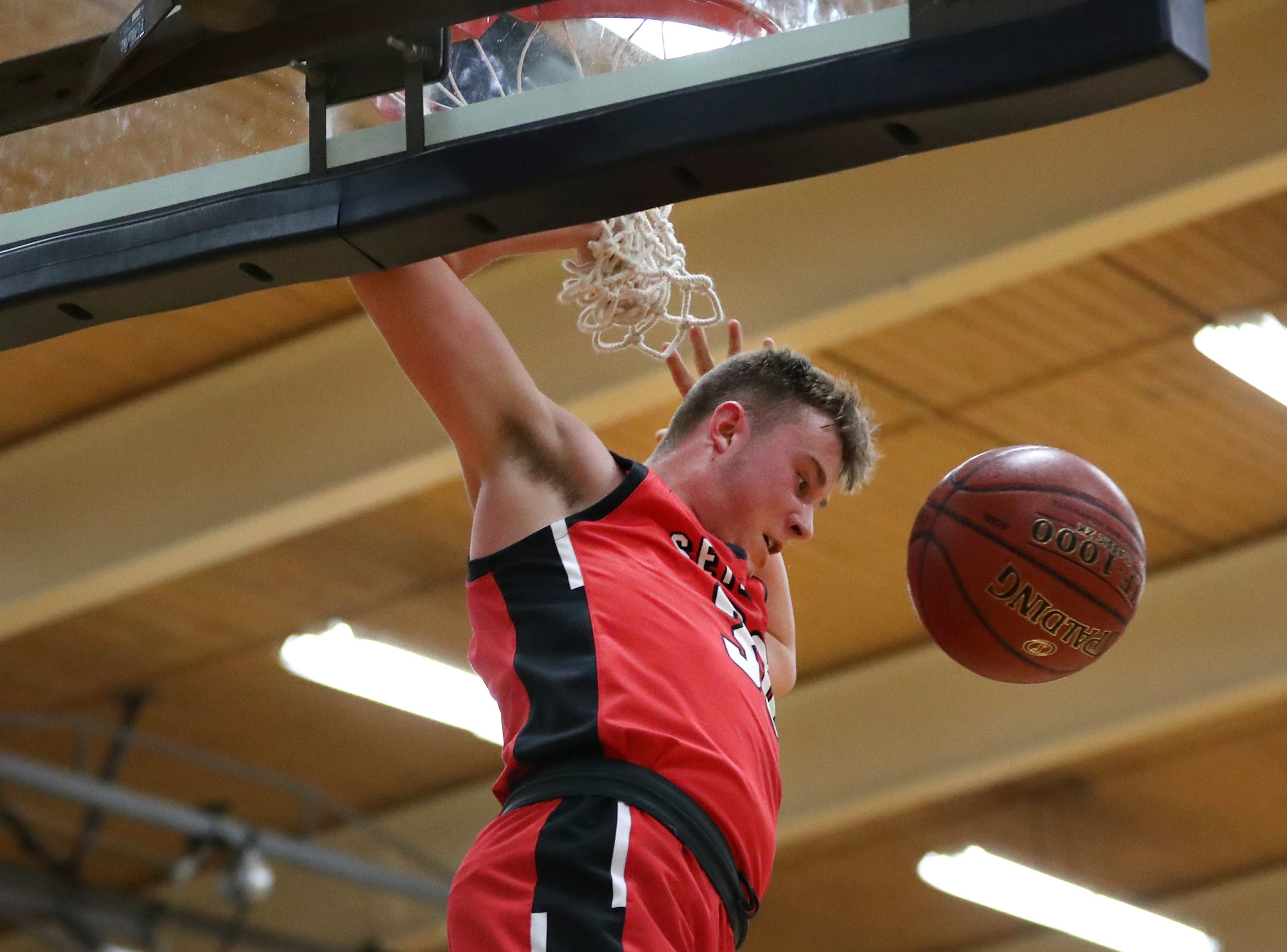 Seymour High School's Trent Blake scores after a teammates ball goes off the backboard against Xavier High School Friday, Feb. 8, 2019, in Appleton, Wis. Xavier High School defeated Seymour 92-50.Danny Damiani/USA TODAY NETWORK-Wisconsin