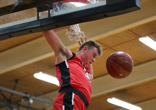 Seymour's Trent Blake scores against Xavier during a game Feb. 8 in Appleton.