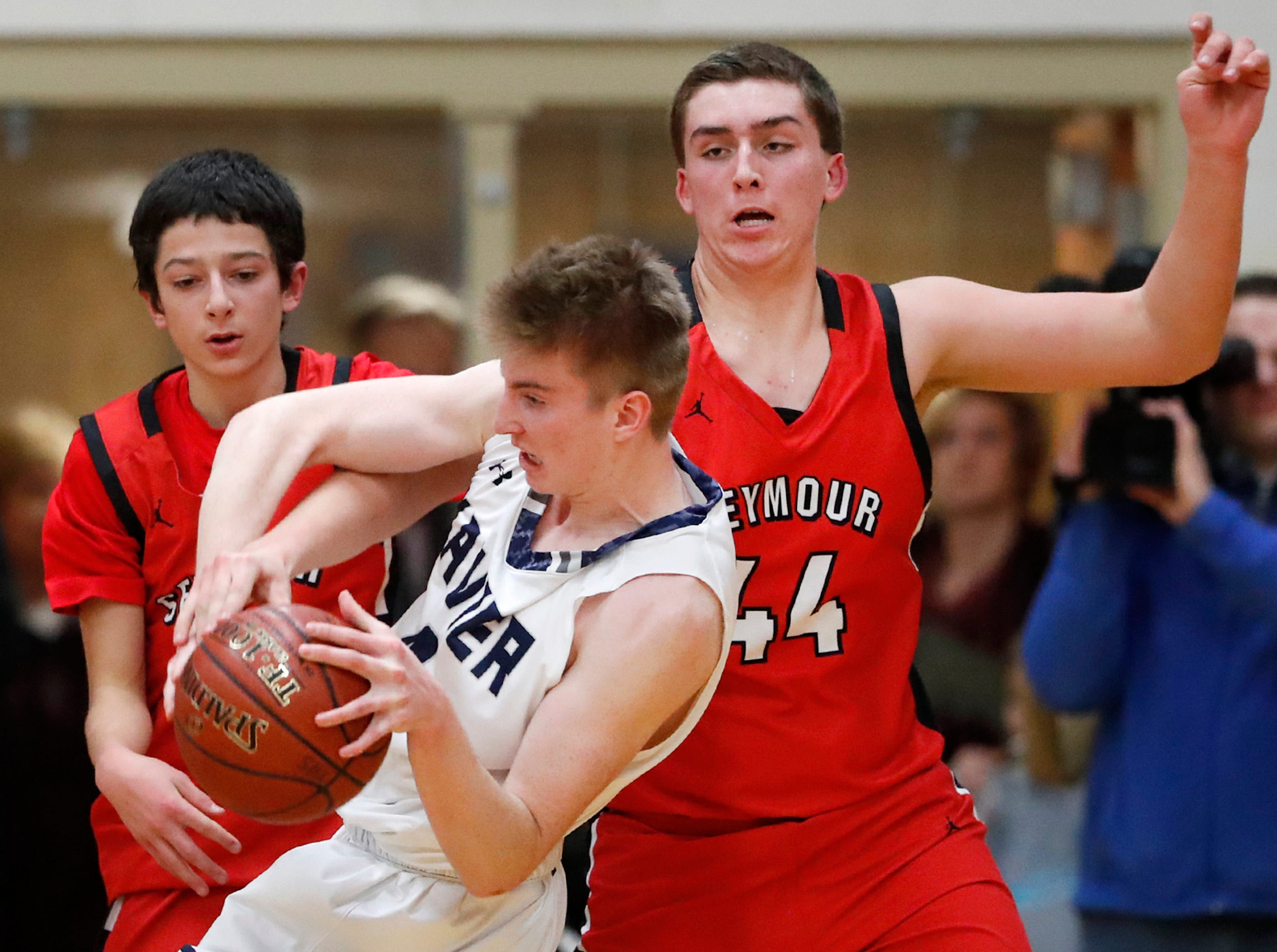 Xavier High SchoolÕs John Bunks, Jr. tries to keep control of the ball as Seymour High School's Tyler VandeCorput closes in Friday, Feb. 8, 2019, in Appleton, Wis.Danny Damiani/USA TODAY NETWORK-Wisconsin