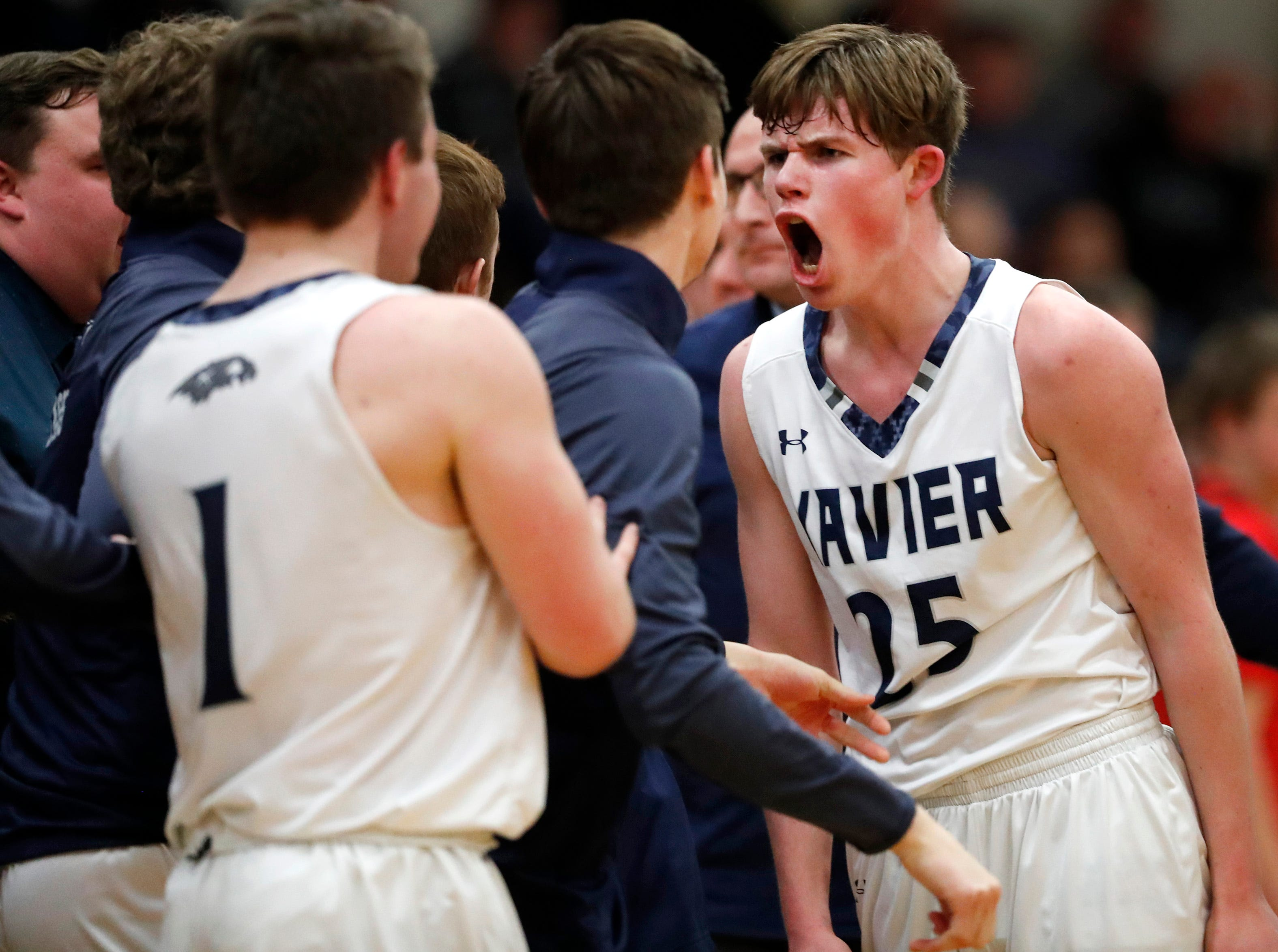 Xavier High School's Trent Twombly celebrates as he enters a timeout huddle after the Hawks went up 62-35 over Seymour Friday, Feb. 8, 2019, in Appleton, Wis. Xavier High School defeated Seymour 92-50.Danny Damiani/USA TODAY NETWORK-Wisconsin