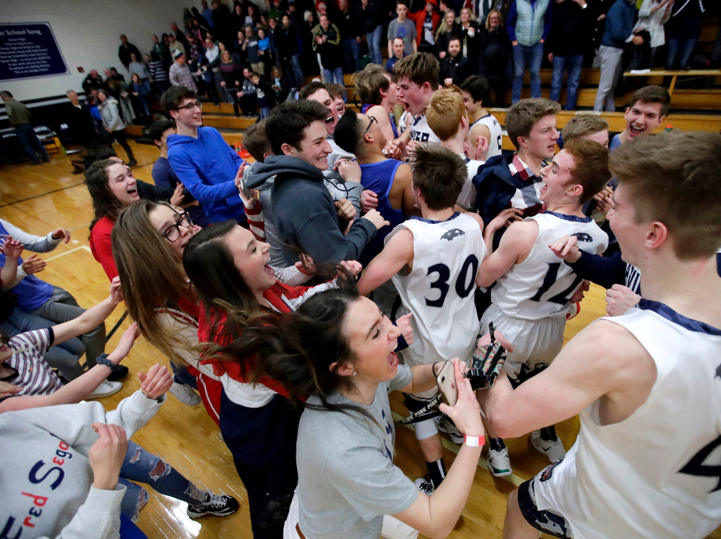 Xavier High School fans and players collide after their 92-50 win over Seymour High School Friday, Feb. 8, 2019, in Appleton, Wis.Danny Damiani/USA TODAY NETWORK-Wisconsin