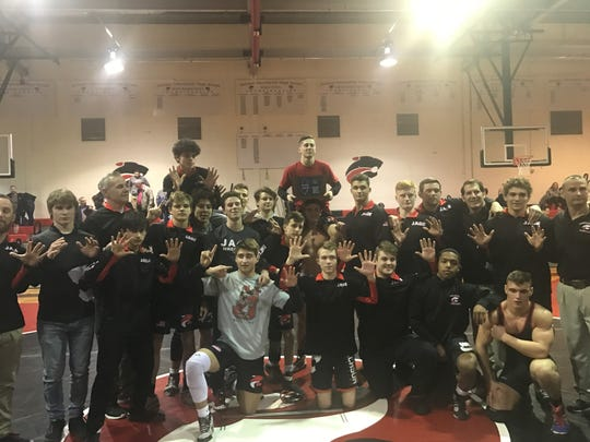 Jackson Memorial High School wrestling team celebrates its Central Jersey Group IV Sectional title win Feb. 8, 2019.