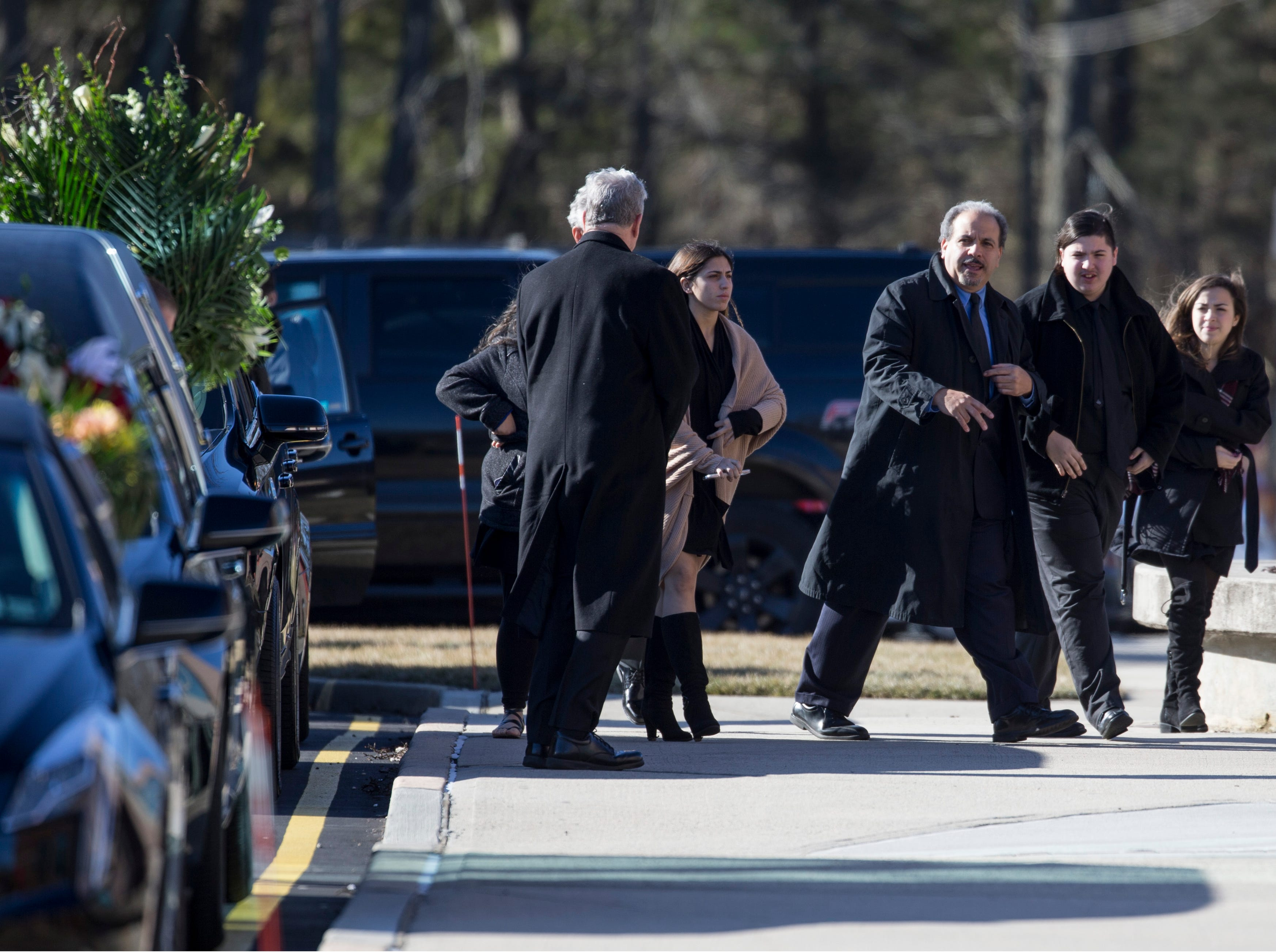Mourners arrive at the Co-Cathedral of St. Robert Bellarmine for the funeral of Denise Bartone who lost her life earlier this week.   Freehold Township, NJSaturday, February 9, 2019