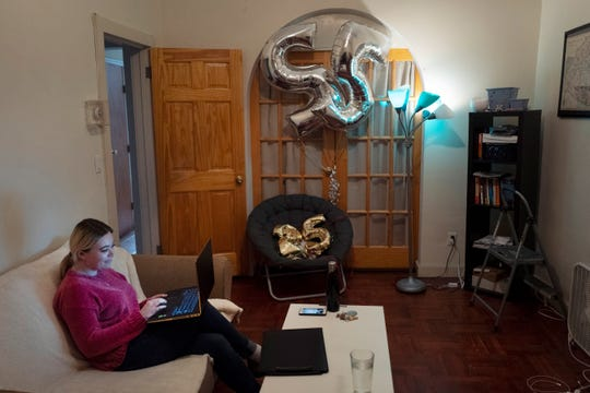 Caitlin Powers sits in the living room of her Brooklyn apartment in New York and has a telemedicine video conference with physician Dr. Deborah Mulligan. Widespread smartphone use, looser regulations and employer enthusiasm are helping to expand access to telemedicine, where patients interact with doctors and nurses from afar, often through a secure video connection.