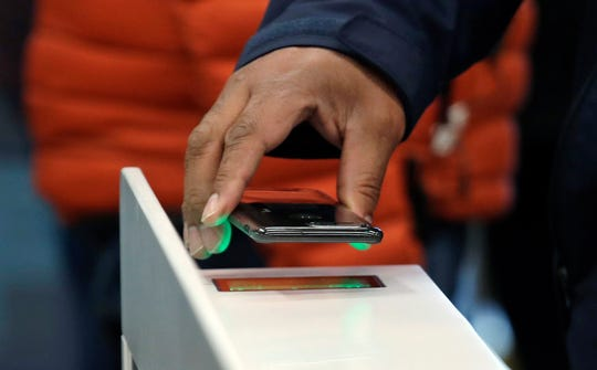 A shopper scans an Amazon Go app on a cellphone while entering an Amazon Go store in Seattle. Get ready to say good riddance to the checkout line. A year after Amazon opened its first cashier-less store, startups and retailers are racing to get similar technology in other stores throughout the world, letting shoppers buy groceries without waiting in line.