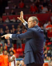 Rutgers Scarlet Knights head coach Steve Pikiell signals to his team during the first half against the Illinois Fighting Illini at State Farm Center.