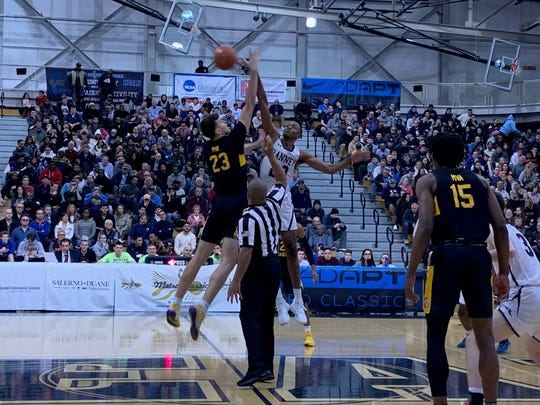Ranney's Scottie Lewis and Montverde Academy's Balsa Koprivica (23) go for the jump ball Friday night at the Metro Classic at Kean University