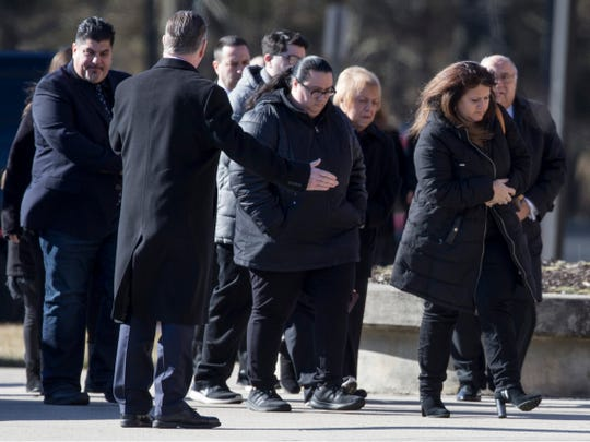 Mourners arrive at the Co-Cathedral of St. Robert Bellarmine for the funeral of Denise Bartone who lost her life earlier this week.   