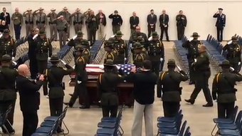 The flag-draped casket of Border Patrol Agent Donna Doss is brought into the Taylor County Coliseum for her memorial service on Friday, Feb. 8, 2019.