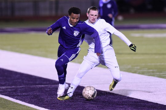 Wylie's Josiah Tuegel turns from a Stephenville defender with the ball at Bulldog Stadium on Friday, Feb. 8, 2019. The game ended in a 2-2 tie.