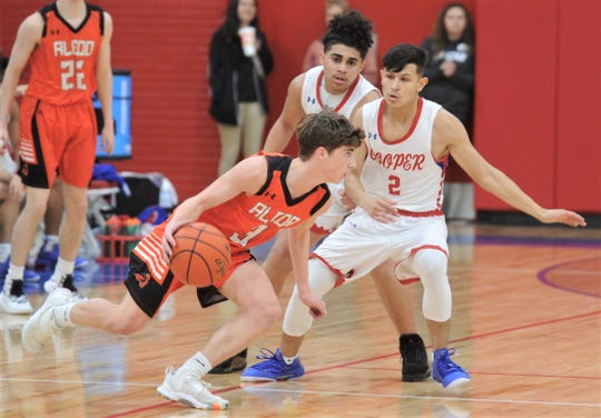 Cooper's Jose Rodriguez (2) and Noah Garcia defend against Aledo's Reid Dietrich. Cooper beat the Bearcats 48-37 in the District 4-5A game Friday, Feb. 8, 2019, at Cougar Gym.
