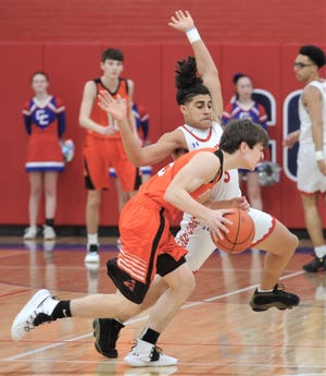 Cooper's Noah Garcia defends against an Aledo player. The Cougars beat Aledo 48-37 in the District 4-5A game Friday, Feb. 8, 2019, at Cougar Gym.