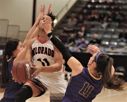 Colorado City's Mia Monroe splits two Merkel defenders as she drives to the basket in the first half. Merkel won the District 5-3A seeding game 39-36 Friday, Feb. 8, 2019, at McMurry's Kimbrell Arena to nab the No. 2 seed going into the playoffs.