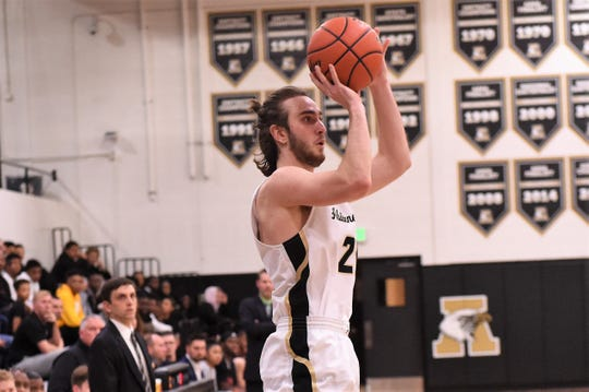 Abilene High senior Brian Patton (21) takes a shot against Euless Trinity at Eagle Gym on Friday, Feb. 8, 2019. The Eagles fell 59-55 on Senior Night.