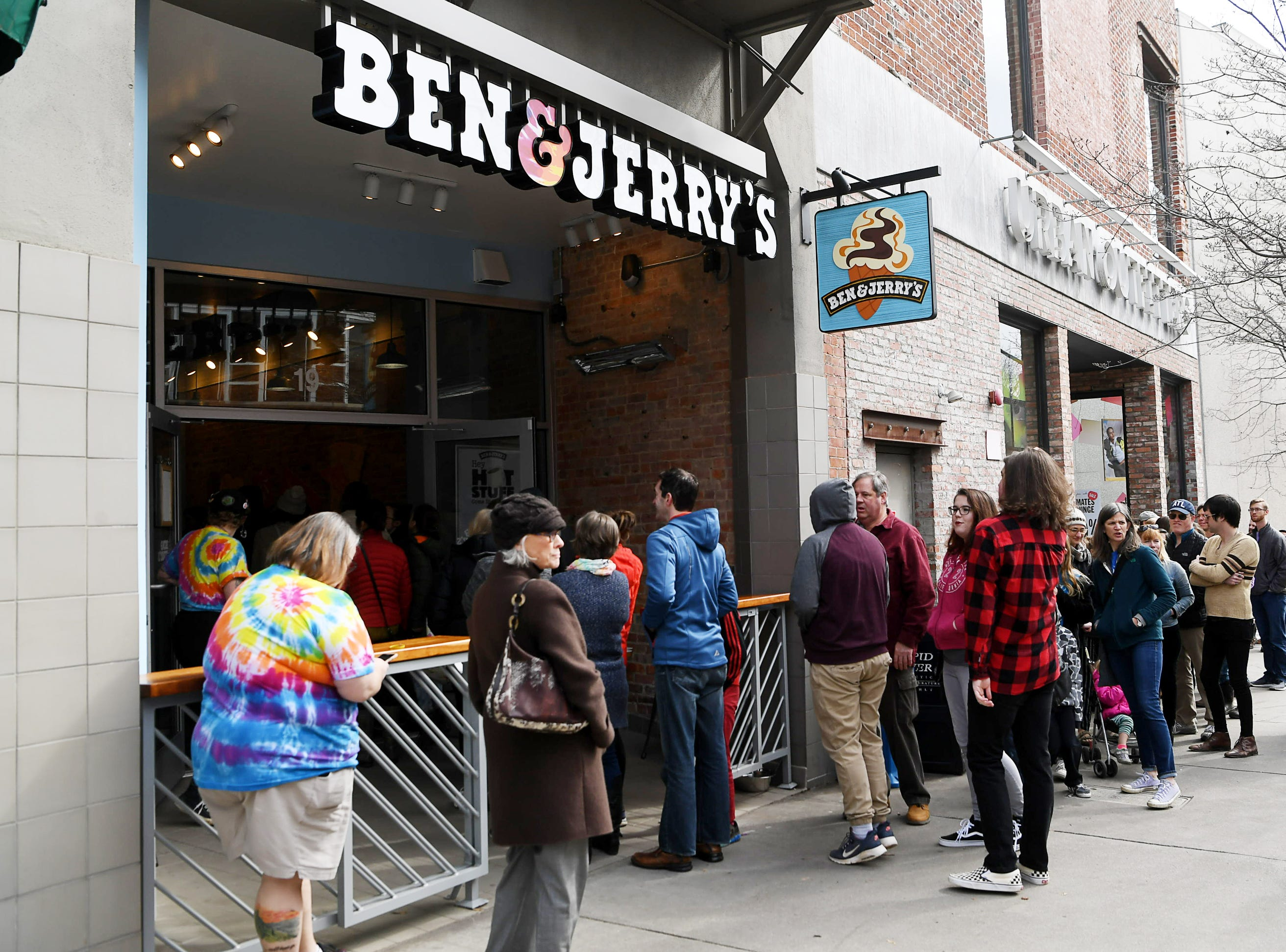 People wait in line for a free scoop of ice cream and to meet the founders of Ben and Jerry's in Asheville Feb. 9, 2019.