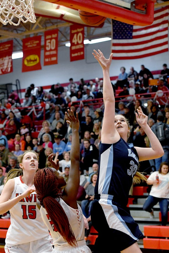 Enka's Maddie Breedlove goes up for a shot above Erwin's Nautica Smiley during their game at Erwin High School on Feb. 8, 2019. The Lady Warriors defeated the Sugar Jets 68-46 to claim the WMAC regular season title.