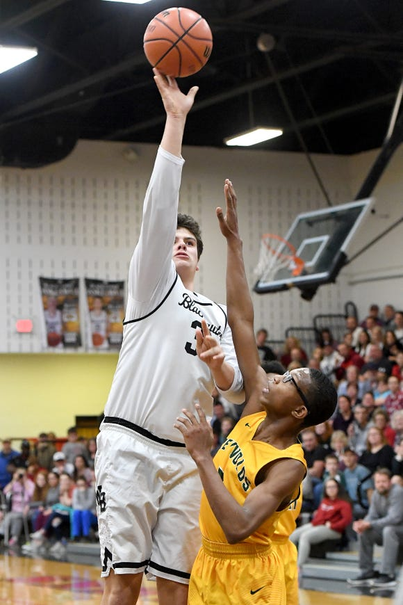 North Buncombe's Spencer Harris goes up for a shot against Reynolds' Acesa Jackson during their game at North Buncombe High School on Feb. 8, 2019. The Blackhawks defeated the Rockets 72-68.