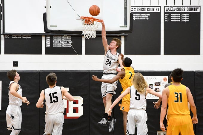 North Buncombe's Ren Dyer leaps up to dunk the ball as he is fouled by Reynolds' Acesa Jackson during their game at North Buncombe High School on Feb. 8, 2019. The ball came down on the rim and bounced off, not going in the net.