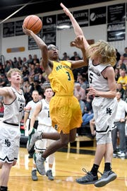 Reynolds' Acesa Jackson goes up for a shot against North Buncombe's Malachi Hammond during their game at North Buncombe High School on Feb. 8, 2019. The Blackhawks defeated the Rockets 72-68.