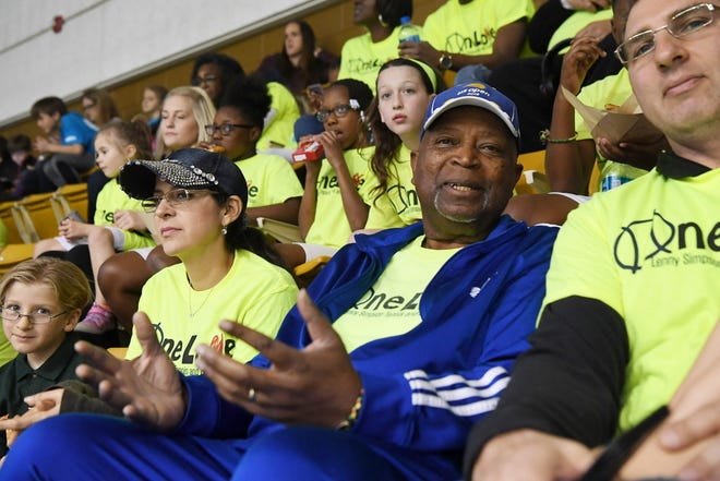 Lenny Simpson, executive director of the OneLove tennis and education fund, watches the first day of Fed Cup competition with participants from his organization Feb. 9, 2019.
