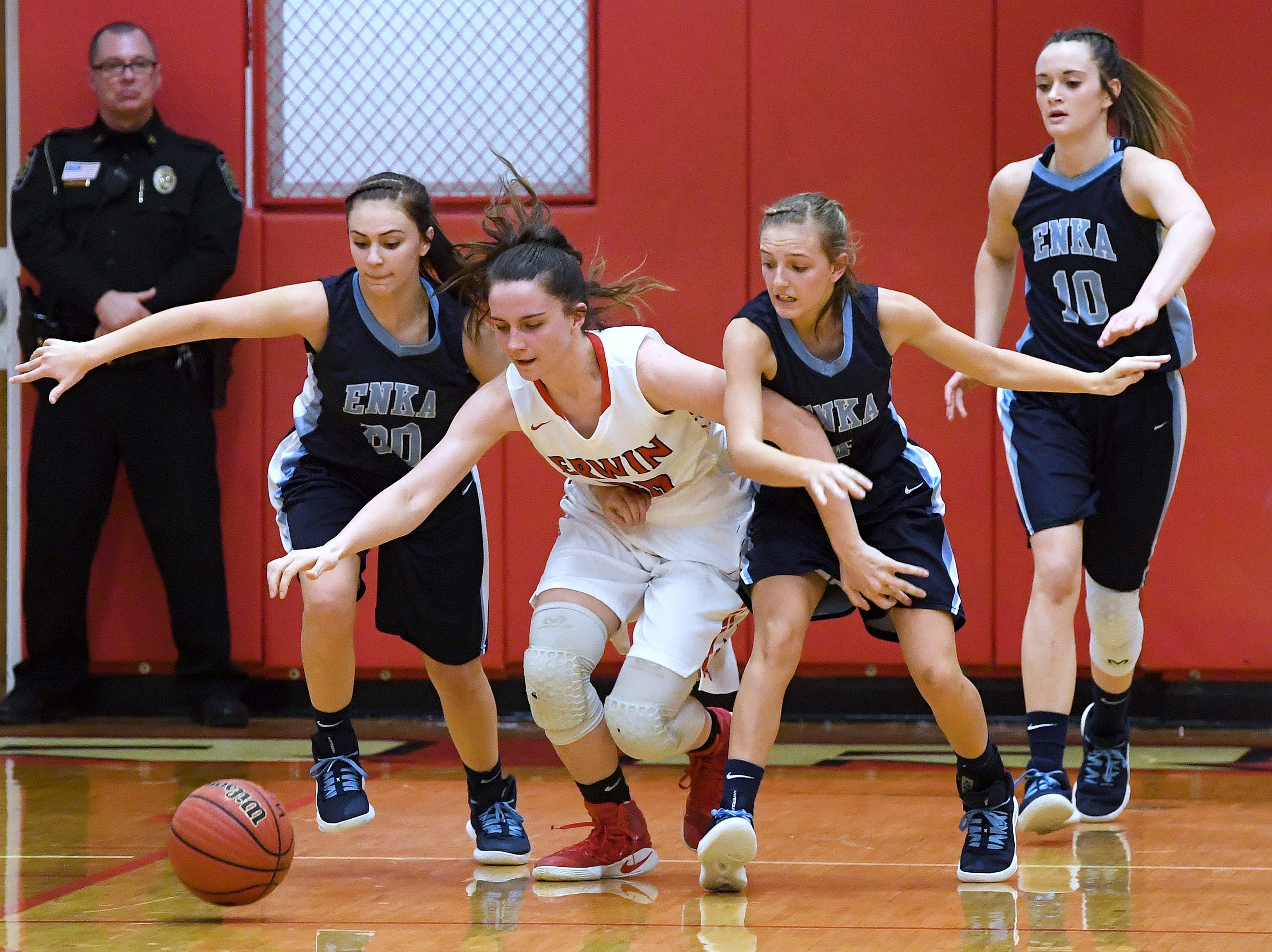 Erwin's Kaitlyn Messer pushes through Enka's Mae Cordiale, left, and Peyton Cathey as they battle for the ball during their game at Erwin High School on Feb. 8, 2019. The Lady Warriors defeated the Sugar Jets 68-46 to claim the WMAC regular season title.