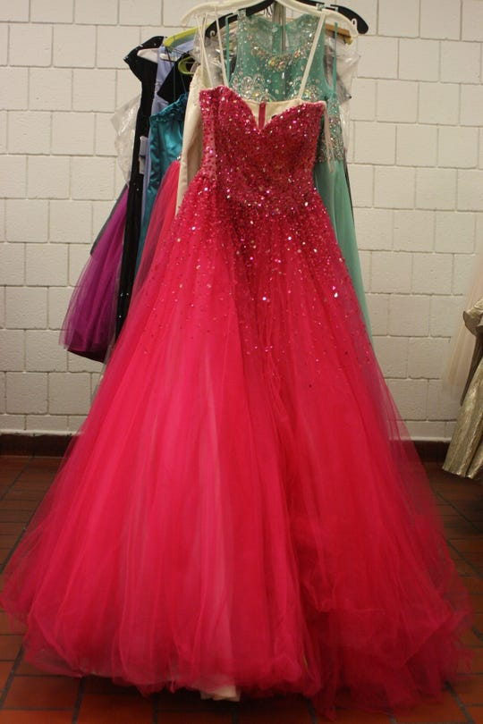 Binghamton High School senior Shaunay Williams, 18, picked out a sparkly hot pink prom dress during a prom dress giveaway hosted by Binghamton High School's Sisterz for Sisters club.