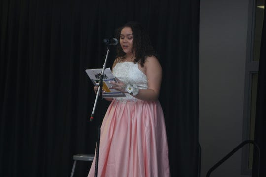 Dream Wallace, a 17-year-old senior at Binghamton High School and president of Sisterz 4 Sisters club gives opening remarks during the club's prom dress fashion show.