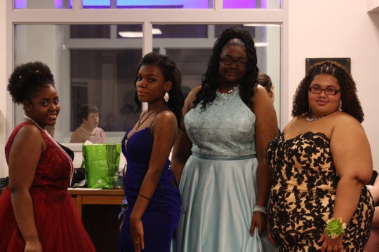 Binghamton High School students modeled prom dresses during a fashion show hosted by the school's Sisterz 4 Sisters club Friday evening.