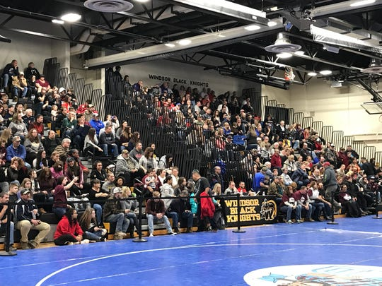 Wrestling fans pack the stands Friday at Windsor for The Section 4 Division II Tournament.