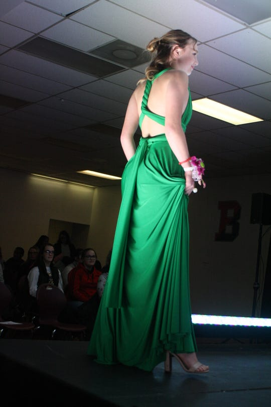 Madison Weinheimer models a kelly green prom dress during a prom dress fashion show, hosted by Binghamton High School's Sisterz 4 Sisters club.
