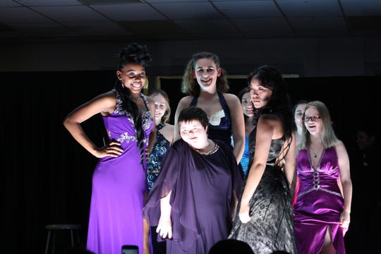 Binghamton High School students model dresses  during a fashion show hosted by the school's Sisterz 4 Sisters club Friday evening.