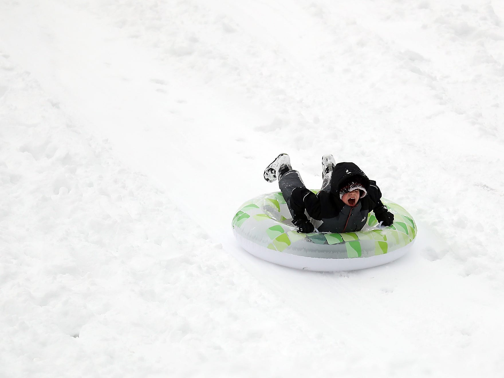 Sledders at Silver Ridge Elementary School in Silverdale on Saturday, February 9, 2019.