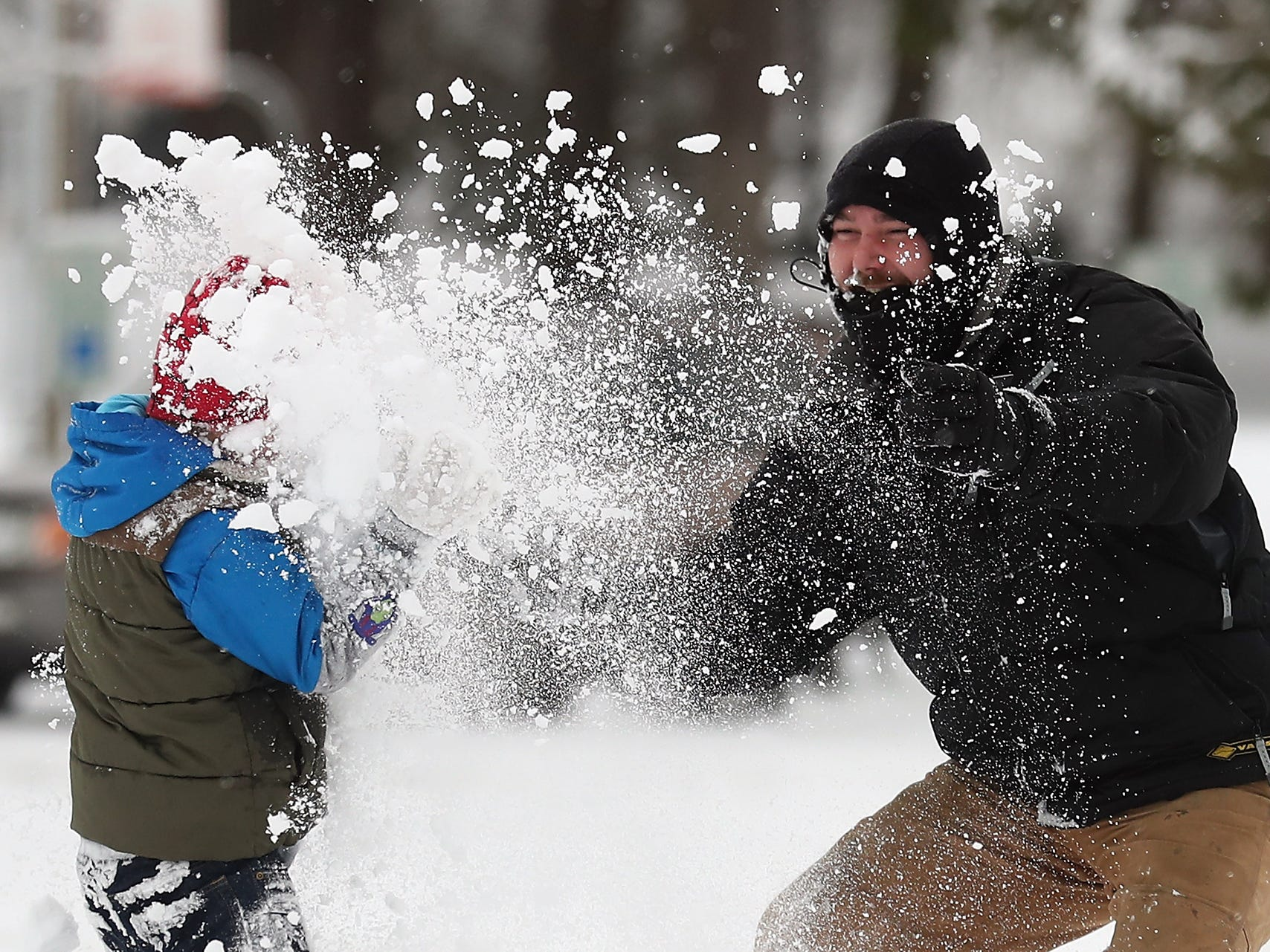 A snowball sneak attack by Sebastian Fletcher, 7, (left) goes horribly wrong when Brady Walster retaliates with a handful of loose snow at Evergreen Rotary Park in Bremerton on Saturday, February 9, 2019.