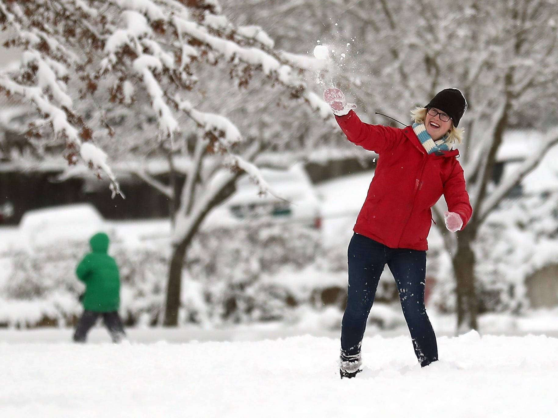 Joelle Dempster lets a snowball fly at Evergreen Rotary Park in Bremerton on Saturday, February 9, 2019.