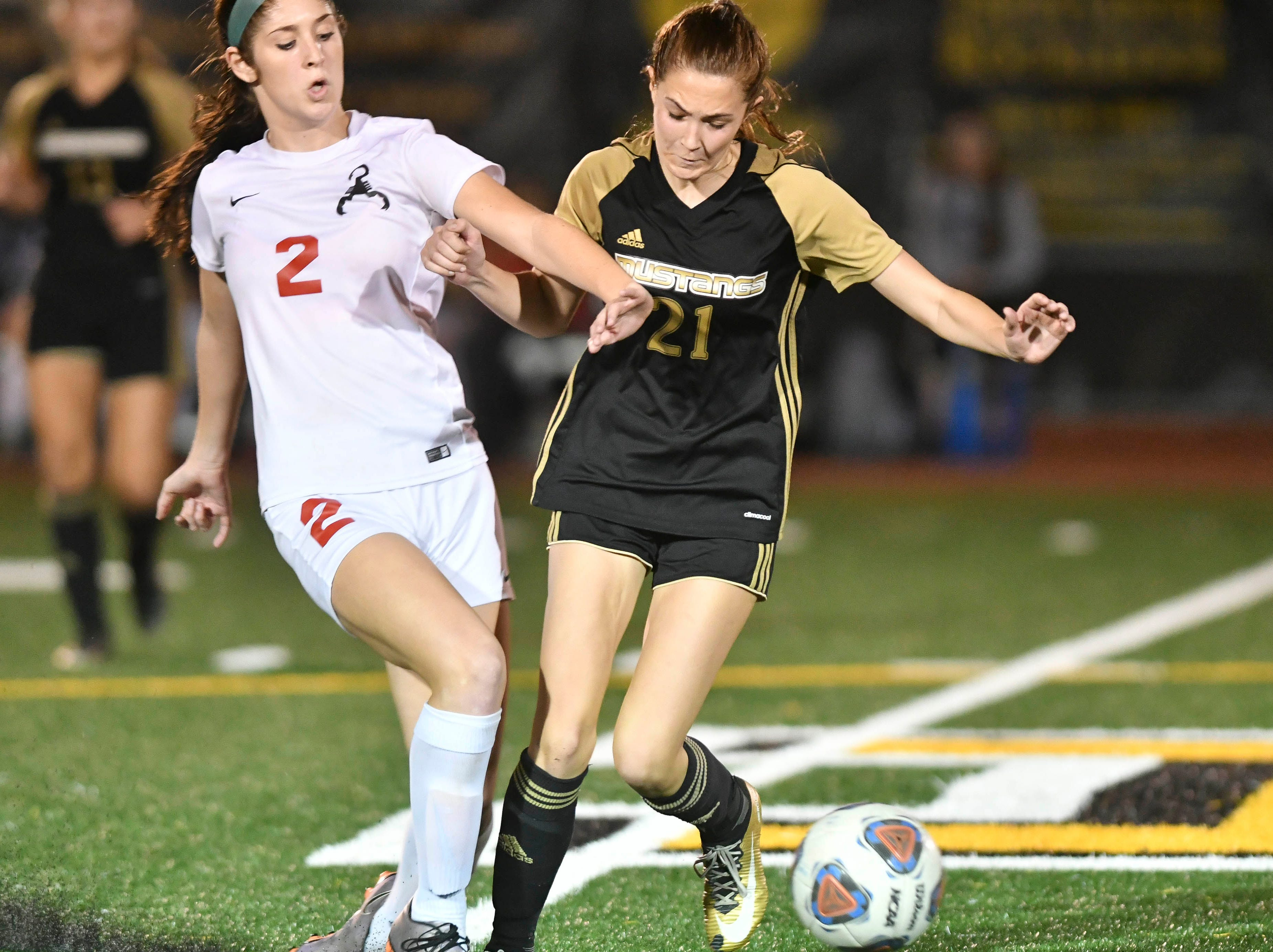 Abbey Beres of Satellite and Ashleigh Sweat of Merritt Island get tangled up during Friday's Class 3A regional semifinal.