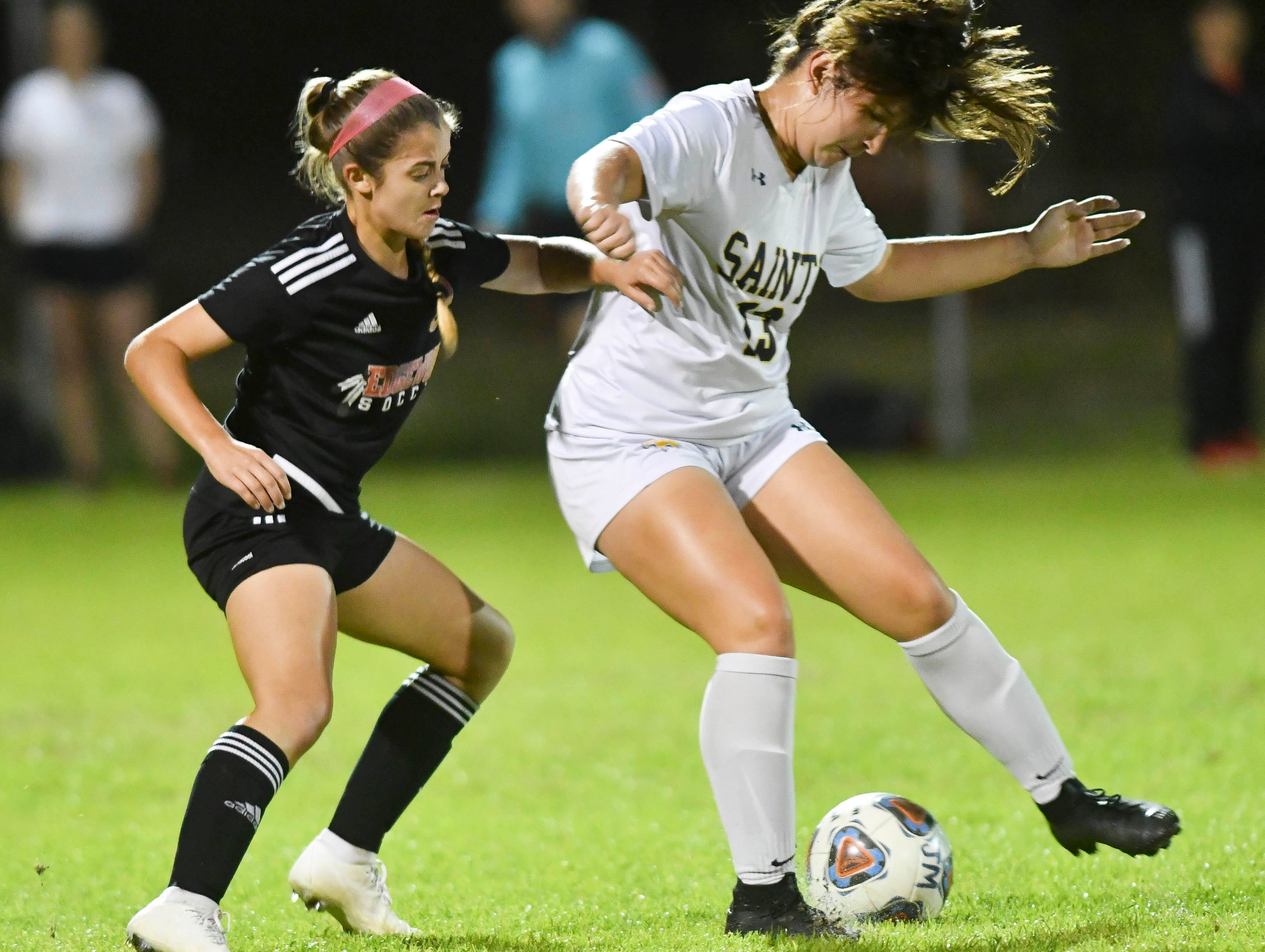 Romie Llewellyn of Trinity Prep keeps the ball away from Julia Passarelli of Edgewood during Friday's Class 2A regional semifinal at Edgewood Jr/Sr High.